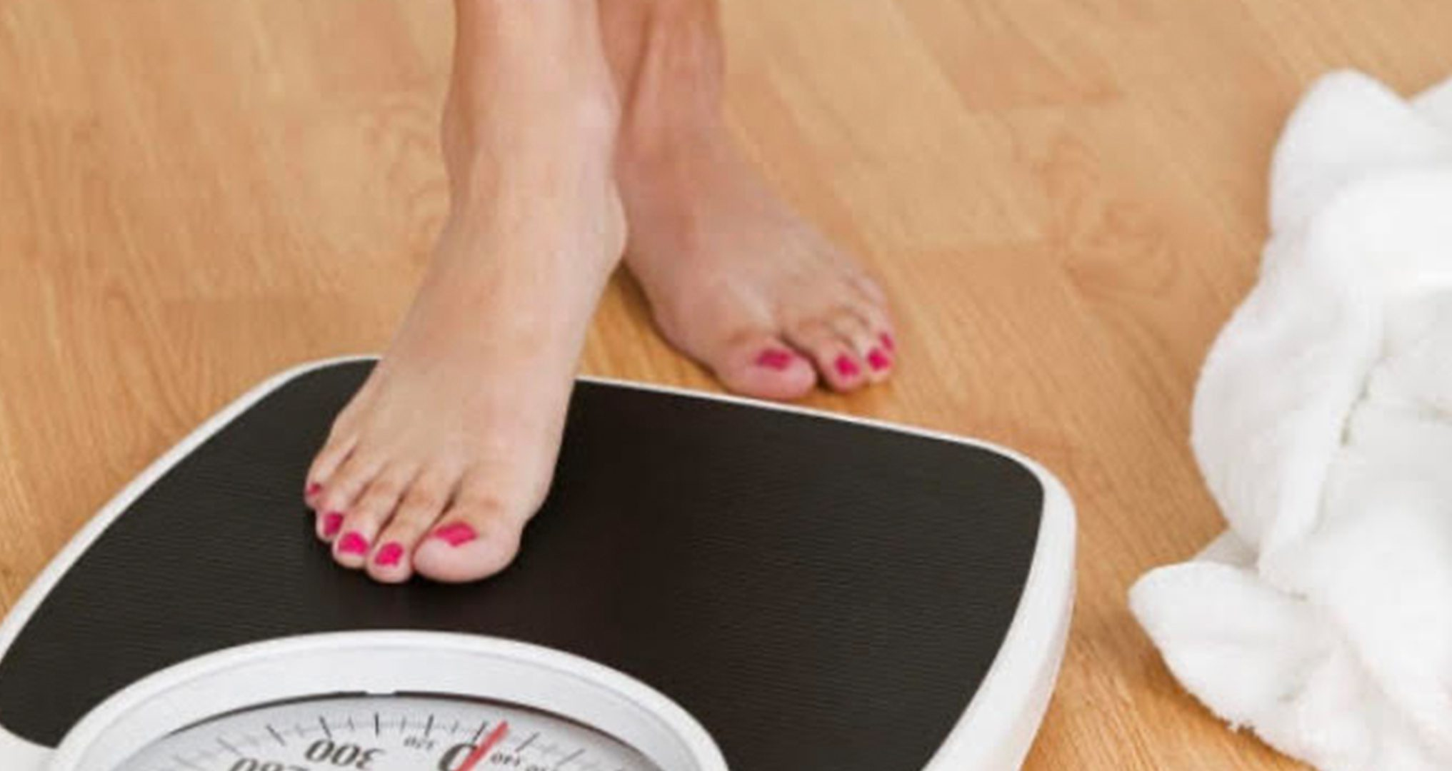 Woman checking weight.